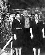 employers portrait with Christmas tree decoration USA 1946