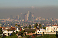 The smog is visible in downtown Los Angeles Skyline on Thursday Feburary 14, 2013. Los Angeles has some of the most contaminated air in the country. Due to its high overall population density and traffic congestion, the city's air is contaminated with toxic chemicals. Studies have shown that traffic-induced pollution is linked to increased likeliness of cancer, along with complications during pregnancy. Many industries in the area also emit toxic chemicals when manufacturing their products. Although this helps to stimulate the local economy, it comes at the high price of potential health hazards to the general public. A study published in February 2012 states that someone's risk of having a stroke could be raised by 34% if they had been exposed to at least a ?moderate? amount of air pollution that day. This statistic was created after studying the medical records of over 1700 stroke victims. Citizens of Los Angeles consider air pollution to be serious, as over 45% of them believed it to be a ?big problem?. A recent poll shows that according to the people of Southern California and more northern areas like the Bay Area and the Central Valley, air pollution is the most important environmental problem that California faces today. (Photo by Ringo Chiu/PHOTOFORMULA.com).