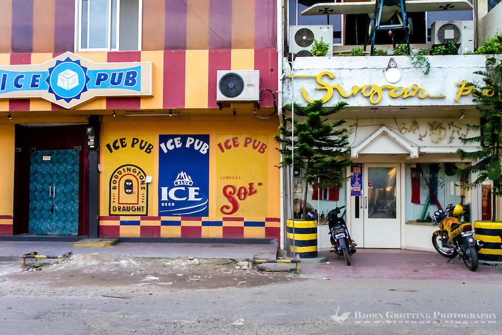 Indonesia, Riau, Batam. Two of the many pubs in Nagoya, Ice Pub and Sugar Pub.