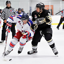 NORTH YORK, ON - Feb 9 : Ontario Junior Hockey League Game Action between North York Rangers Hockey Club and the Trenton Golden Hawks Hockey Club.  Ted Hunt #9 of the North York Rangers Hockey Club skates with the puck while being checked by Brian Hurlimann #93 of the Trenton Golden Hawks Hockey Club.<br /> (Photo by Phillip Sutherland / OJHL Images)