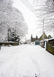 Monday January 21 Saint Marys Church Lytchgate and Gattey Hall on Priory Road,  Winter Weather reaches Ecclesfield in Sheffield South Yorkshire with the promise of more to follow .21 January 2013.Image © Paul David Drabble
