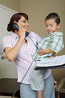 Business woman using phone with son at home