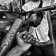 San Cristobal, Tachira State - Venezuela. Fellow students supporters and friends of Daniel Tinoco show their mortars after Daniel Tinoco,  24 yrs old, was fatally shot the night before by masked men. They explained that for them was not anymore a pacific demostration.