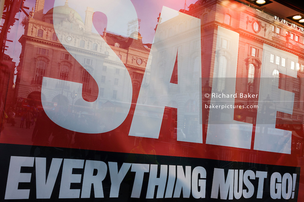 A Sale Everything Must Go poster in Lillywhites window and reflected Regency architecture of nearby buildings  in central London.