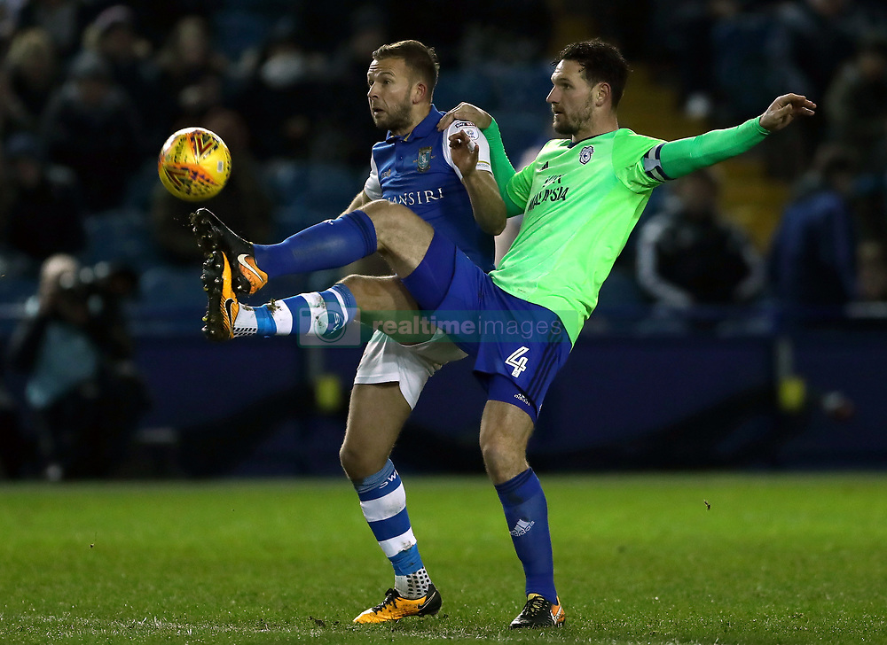 Sheffield Wednesday's Jordan Rhodes (left) and Cardiff City's Sean Morrison battle for the ball