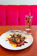 Andaluz Restaurant in Salem, Oregon.  The Grilled Squid with roasted peppers, lime, basil and red wine sauce.