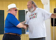 State of Louisiana Agriculture Commissioner Mike Strain speaks with Abita Spring Farmers Market organizer Mike Norman at the Farmers Market on August 7, 2016
