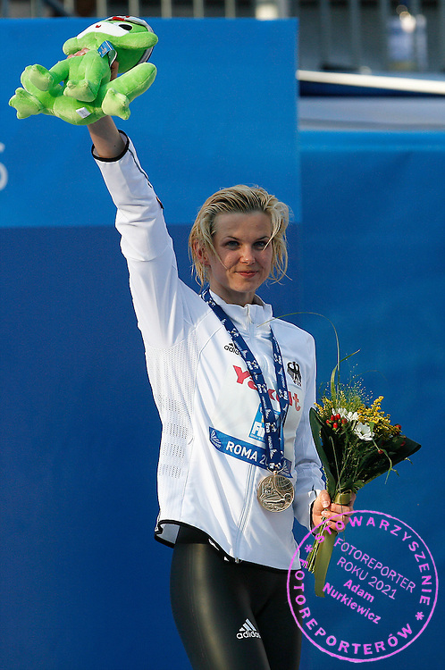 ROME 31/07/2009.13th Fina World Championships.Women's 100m Freestyle - Final.Golden medallist Britta Steffen of Germany celebrates on the podium after setting a world record in the women's 100m freestyle swimming final at the World Championships.photo: Piotr Hawalej / WROFOTO
