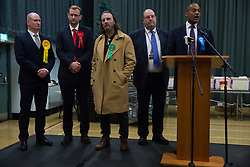 Maidenhead, UK. 13 December, 2019. Conservative candidate Adam Afriyie makes a speech after being re-elected as the Member of Parliament for the Windsor constituency. Pictured (L-R): Julian Tisi (Liberal Democrat), Peter Shearman (Labour), Fintan McKeown (Green), David V. Scott (Returning Officer for the Royal Borough of Windsor and Maidenhead) and Adam Afriyie (Conservative).