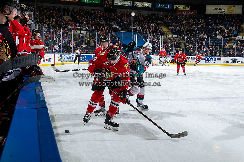 KELOWNA, CANADA - MARCH 2: Ethan Ernst #19 of the Kelowna Rockets checks Mason Mannek #26 and Nick Perna #3 of the Portland Winterhawks  on March 2, 2019 at Prospera Place in Kelowna, British Columbia, Canada.  (Photo by Marissa Baecker/Shoot the Breeze)