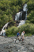 Hiking near a waterfall Harriman Fiord, Prince William Sound, Alaska
