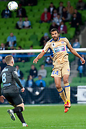 Newcastle Jets defender Nikolai Topor-Stanley (44) headers the ball away from Melbourne City midfielder Riley McGree (8) at the FFA Cup Round 16 soccer match between Melbourne City FC v Newcastle Jets at AAMI Park in Melbourne.