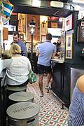 Customers inside famous historic Los Gatos Cervecerias bar, Madrid city centre, Spain