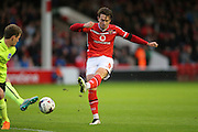 Walsall striker, Tom Bradshaw shoots during the Capital One Cup match between Walsall and Brighton and Hove Albion at the Banks's Stadium, Walsall, England on 25 August 2015.