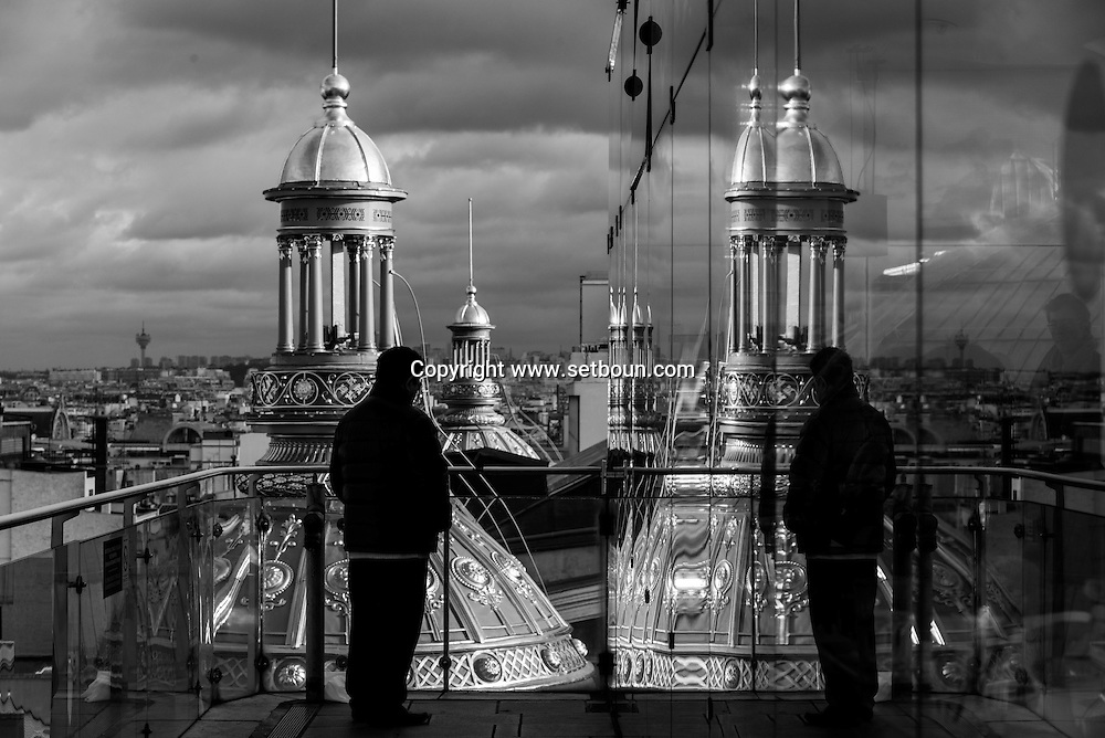 France. Paris. 9th district. , Paris cityscape and rooftops view from from the terrace  of the Printemps department store  Paris  France  / panorama de paris et les toits vu depuis la terrasse du printemps hausmann, paris