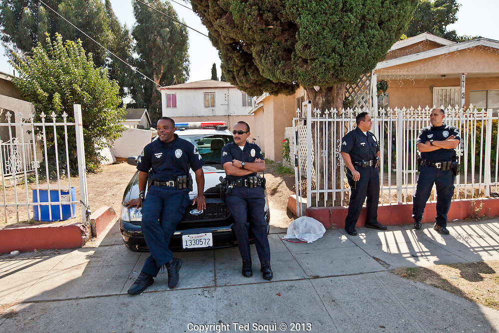 LAPD watching outside the services.<br /> Funeral services for Kevin &quot;Flipside&quot; White at Macedonia Church in Watts.<br /> White was shot dead in what is believed to be an unprovoked attack during a gang conflict at Watts' Nickerson Gardens and Jordan Downs housing projects.<br /> Flipside, 44, was a founding member of Watts' first major label hip hop act, O.F.T.B. (Operation From The Bottom).