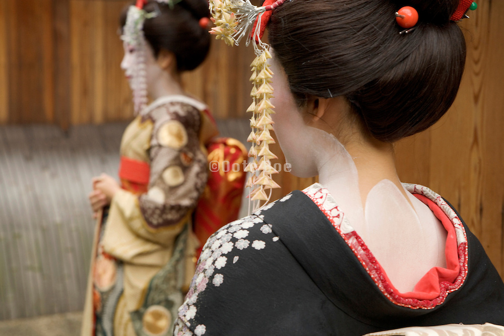 side view of two maiko Kiyomizu district in Kyoto Japan