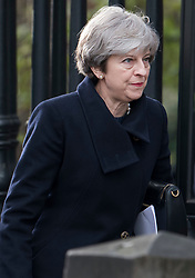 © Licensed to London News Pictures. 14/12/2017. London, UK. British prime minister THERESA MAY leaves St Paul's Cathedral in London following the Grenfell Tower National Memorial Service mark the six month anniversary of the Grenfell Tower fire. The service is attended by survivors of the fire and relatives of those who lost their lives in the fire, as well as members of the emergency services and members of the Royal family.  Over 70 people were killed when a huge fire ripped though 24-storey Grenfell Tower block in west London in June 2017.   Photo credit: Ben Cawthra/LNP