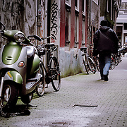 Vespa scooter in alley, Amsterdam, Netherlands (September 2006)