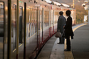 early morning businesspeople waiting for the train to open the doors Japan
