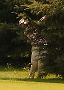 2007 Boyne Tournament of Champions winner Michael Harris of Troy plays his second shot from behind a pine tree on the par 5 18th of Boyne Mountains Alpine course.