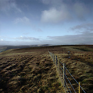 'Border fence, Cheviot hills, 2014' from 'A Fine Line - Exploring Scotland's Border with England' by Colin McPherson.<br /> <br /> The fence which marks the border between Scotland and England, high up on the slopes of the Cheviot hills in the Scottish Borders.<br /> <br /> The project was a one-year exploration of the border between the two historic nations, as seen from the Scottish side of the frontier.<br /> <br /> Colin McPherson is a photographer and visual artist based in north west England. In 2012 he was one of the founding members of Document Scotland, a collective of four Scottish documentary photographers brought together by a common vision to witness and photograph the important and diverse stories within Scotland at one of the most important times in our nation's history.<br /> <br /> 'A Fine Line' will be shown for the first time in public at Impressions Gallery, Bradford, from July 1 until September 27, 2014 to coincide with the Scottish Independence referendum.