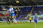 Defensive header from Reading's Michael Hector  during the Sky Bet Championship match between Reading and Bolton Wanderers at the Madejski Stadium, Reading, England on 21 November 2015. Photo by Mark Davies.