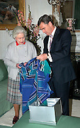 HER MAJESTY QUEEN ELIZABETH II ACCEPTS THE PREMIER OF VICTORIA JOHN BRUMBY AND HIS WIFE ROSEMARY MACKENZIE INTO BALMORAL NEAR ABERDEEN SCOTLAND..THE PREMIER IS THERE TO DISCUSS THE VICTORIAN BUSHFIRES. HE PRESENTED A TARTAN KNEE RUG, TIES FOR PRINCE PHILIP AND GRANDSONS AND A SCARF  FOR THE PRINCESS ROYAL A SCARF  ALL IN VICTORIA TARTAN TO HER MAJESTY HOSTED A LUNCH.PIC JAYNE RUSSELL 05.10.09