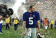 New York Giants quarterback Kerry Collins walks off the field after his team lost the Super Bowl to the Baltimore Ravens in Tampa, Florida, Jan. 28, 2001.