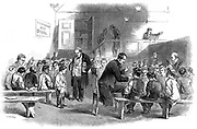 Teaching boys to read in The Ragged School Union (formed 1844) school, Lambeth, London.  From 'The Illustrated London News' 11 April 1868. Wood engraving.