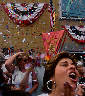 GLOUCESTER, MA- JUNE 29, 2003:  Citizens cheer as confetti falls from windows during the annual celebration paying homage to St. Peter, the patron saint of fishermen in Gloucester, MA. The festa takes place on the weekend closest to the Feast Day of St. Peter, June 29. .(Photo by Robert Falcetti) . .