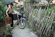 "ZHANGZHOU, CHINA - (CHINA OUT) <br /> <br /> ""Movie Theater"" In Rural China <br /> <br /> Movie projectionist Qiu Wensheng carrying a set of screening facilities arrives at a village  in Zhangzhou, Fujian Province of China. There are many movie projectionists working in rural areas to show movies for farmers. <br /> ©Exclusivepix"