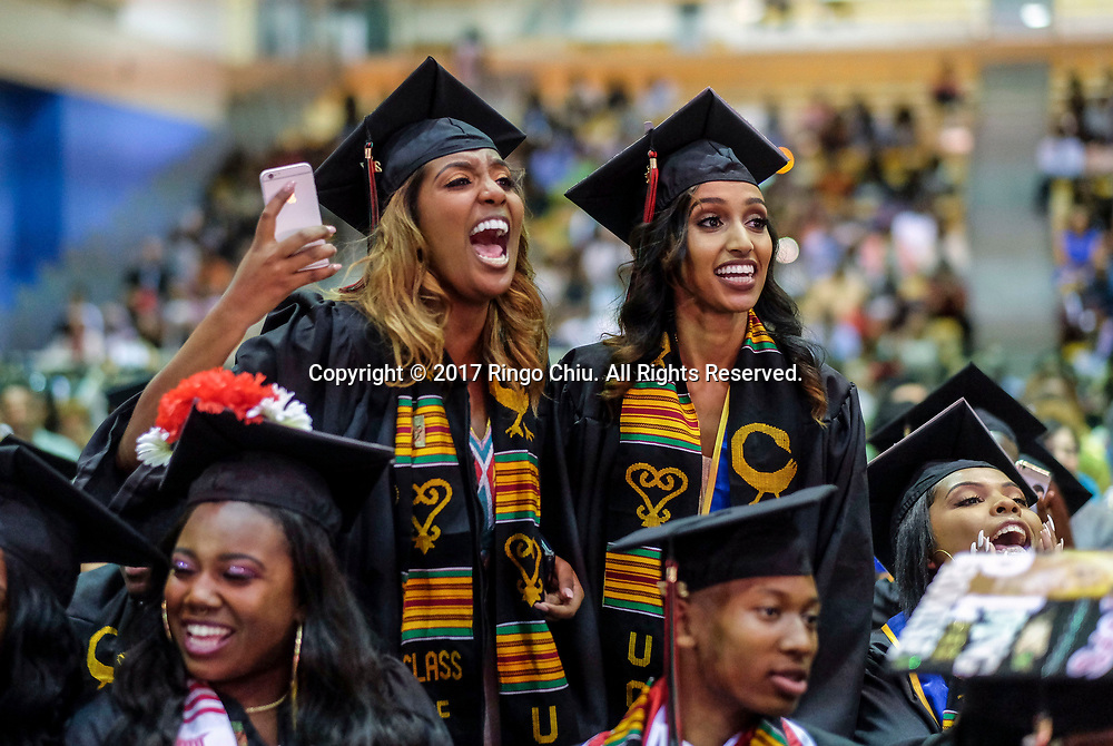 RIVERSIDE, CA - JUNE 11, 2017: Graduates Namuna Tefera, left, and Bilen Teclemariam react to speaker during the Black Graduation Ceremony at University of California, Riverside, Sunday June 11, 2017. (Photo by Ringo H.W. Chiu / For The Times)(Photo by Ringo Chiu)<br /> <br /> Usage Notes: This content is intended for editorial use only. For other uses, additional clearances may be required.