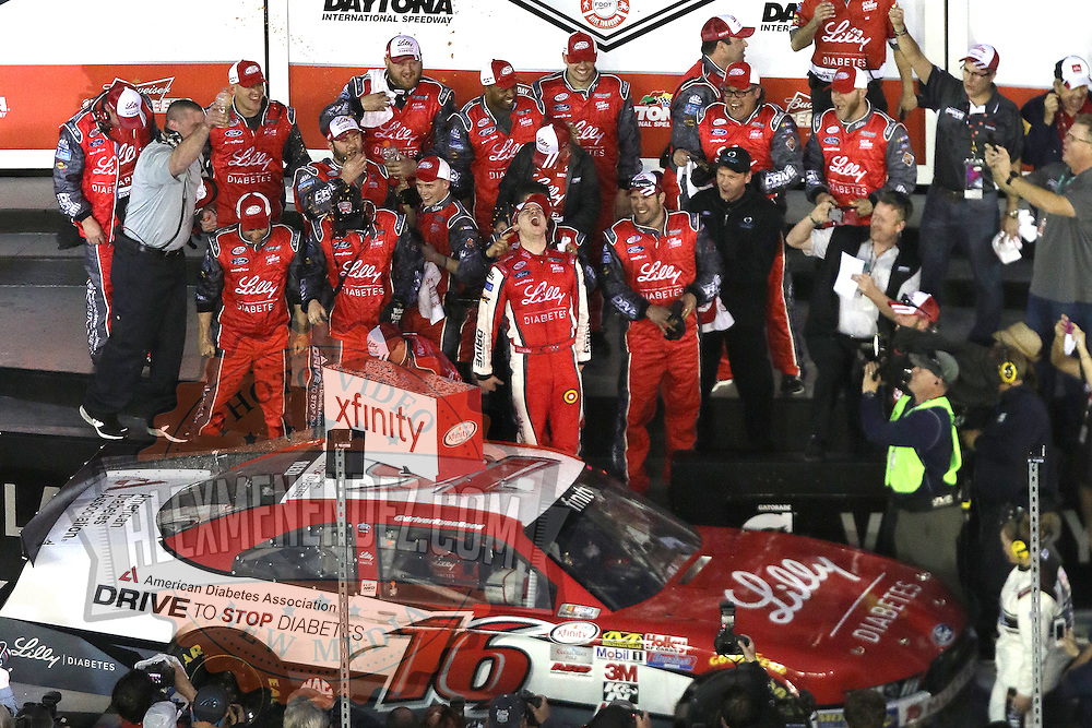 Ryan Reed (16) celebrates his victory after winning the Alert Today Florida 300 XFinity Series race at Daytona International Speedway on Saturday, February 21, 2015 in Daytona Beach, Florida.  (AP Photo/Alex Menendez)