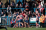 Oldham Roughyeds score a try with seconds on the clock to make it 26-22 to the home side and celebrate in front of their fans during the Kingstone Press Championship match between Oldham Roughyeds and Bradford Bulls at Bower Fold, Oldham, United Kingdom on 2 April 2017. Photo by Mark P Doherty.