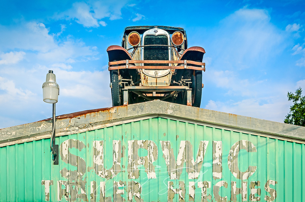 A 1929 Model A Ford sits on the roof of Surwic Trailer Hitches, Sept. 4, 2015, in Memphis, Tennessee. The family-owned business opened in 1964. (Photo by Carmen K. Sisson/Cloudybright)