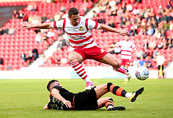 Tommy Rowe of Doncaster Rovers is tackled by Sam Hutchinson of Sheffield Wednesday - Mandatory by-line: Robbie Stephenson/JMP - 26/07/2017 - FOOTBALL - The Keepmoat Stadium - Doncaster, England - Doncaster Rovers v Sheffield Wednesday - Pre-season friendly