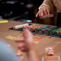 Gamblers play black jack in the Trump Taj Mahal Casino in Atlantic City, NJ on September 3, 2014.  Economically the city is struggling, 4 casinos have already or will be closing in the near future, including Trump Plaza which shutters their doors on September 16.
