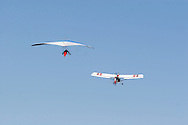 Middletown, N.Y. - A hang glider, at left, being towed by an ultralight plane takes off at Randall Airport on Oct. 8, 2006. ©Tom Bushey