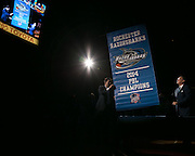 Led by owner Sev Hrywnak, right, the Razorsharks hoist their 2014 PBL Champions banner at the Blue Cross Arena on Saturday, December 6, 2014.