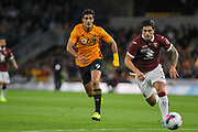 Raúl Jiménez of Wolverhampton Wanderers & Kevin Bonifazi of Torino during the Europa League play off leg 2 of 2 match between Wolverhampton Wanderers and Torino at Molineux, Wolverhampton, England on 29 August 2019.