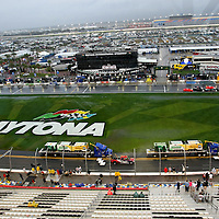 Jet dryers are used to blow the rainwater from the track during a pause in the 56th Annual NASCAR Daytona 500 practice session at Daytona International Speedway on Saturday, February 22, 2014 in Daytona Beach, Florida.  (AP Photo/Alex Menendez)