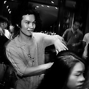 Hair stylist Tran Hung backstage at a fashion show in Hanoi, Vietnam. With government market reforms and a rapidly growing economy, young urban Vietnamese now have more disposable income to spend on mobile phones, slick motorbikes and up-to-date fashions.