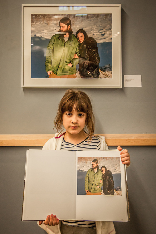 Eight year old Aaliyah Infante at an opening featuring the photography of Ben Huff at the Alaska Humanities Forum in Anchorage.