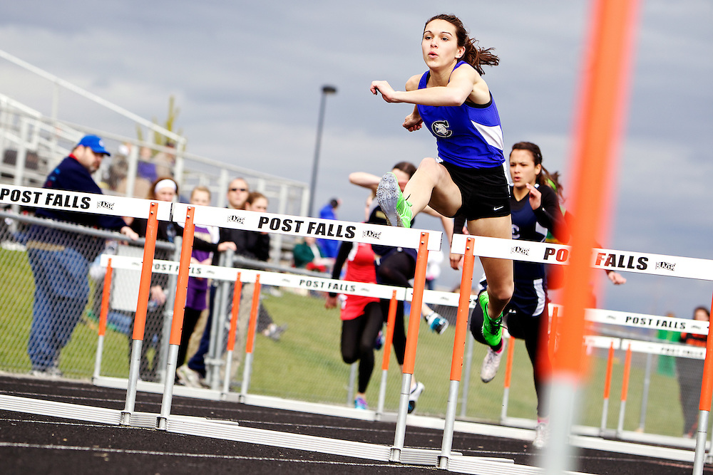Coeur d'Alene High's Morgan Struble elevates over a hurdle Thursday at the District 1 all-star track and field meet Thursday in Post Falls. Struble won the event with a time of 15.1 seconds.