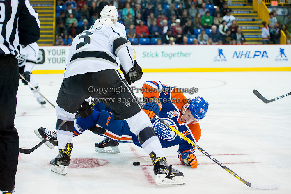 KELOWNA, CANADA - OCTOBER 2: Connor McDavid #97 of the Edmonton Oilers is checked to the ice after the face off against Los Angeles Kings on October 2, 2016 at Kal Tire Place in Vernon, British Columbia, Canada.  (Photo by Marissa Baecker/Shoot the Breeze)  *** Local Caption *** Connor McDavid;