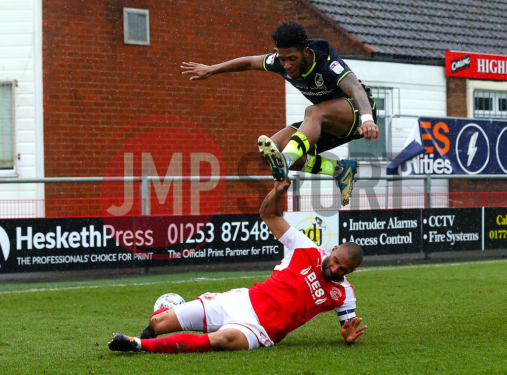 Ellis Harrison of Bristol Rovers jumps over Nathan Pond of Fleetwood Town - Mandatory by-line: Robbie Stephenson/JMP - 02/04/2018 - FOOTBALL - Highbury Stadium - Fleetwood, England - Fleetwood Town v Bristol Rovers - Sky Bet League One