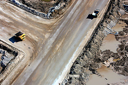 CANADA ALBERTA FORT MCMURRAY 10MAY07 - Aerial view of Suncor Millennium mine north of Fort McMurray, Alberta, Canada. The Alberta Tar Sands are the largest deposits of their kind in the world and their production is the single largest contributor to Canada's greenhouse gas emissions...Alberta's tar sands are currently estimated to contain a crude bitumen resource of 315 billion barrels, with remaining established reserves of almost 174 billion barrels, thus making Canada's oil resources ranked second largest in the world in terms of size...The industry has brought wealth and an economic boom to the region but also created an environmental disaster downstream from the Athabasca river, polluting the lakes where water and fish are contaminated. The native Indian tribes of the Mikisew, Cree, Dene and other smaller First Nations are seeing their natural habitat destroyed and are largely powerless to stop or slow down the rapid expansion of the oil sands development, Canada's number one economic driver...jre/Photo by Jiri Rezac / WWF-UK..© Jiri Rezac 2007..Contact: +44 (0) 7050 110 417.Mobile: +44 (0) 7801 337 683.Office: +44 (0) 20 8968 9635..Email: jiri@jirirezac.com.Web: www.jirirezac.com..© All images Jiri Rezac 2007 - All rights reserved.