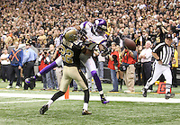 NEW ORLEANS - JANUARY 24: Tracy Porter #22  of the New Orleans Saints knocks the ball away from  Bernard Berrian #87 of the Minnesota Vikings at the NFC Championship Game at the Louisiana Superdome on January 24, 2010 in New Orleans, Louisiana. The Saints won 31-28 in overtime to advance to the Super Bowl for the first time. Photo by Tom Hauck.