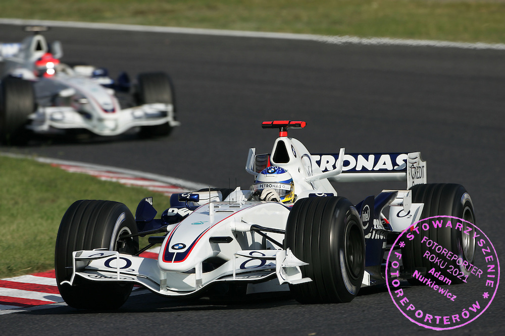08.10.2006 Suzuka, Japan, ..Nick Heidfeld (GER), BMW Sauber F1 Team, F1.06 leads Robert Kubica (POL), BMW Sauber F1 Team, F1.06 - Formula 1 World Championship, Rd 17, Japanese Grand Prix, Sunday Race ..FOT. XPB.CC / WROFOTO..*** POLAND ONLY !!! ***